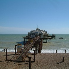 West Pier, May 2002. Taken from the beach, the pier stretches into the sea.   Photo Les Chatfield. licensed under the Creative Commons Attribution 2.0 Generic license.