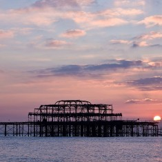 West Pier in ruins with sun setting behind it   Jane Jones (photographer)