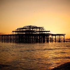 West Pier with orange sunset behind it   Jane Jones (photographer)