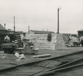 Photograph of men at work, warehouses, Blyth Harbour, Blyth, Northumberland.