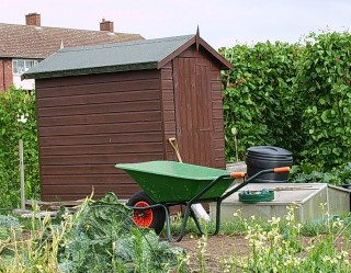 Allotment with wheelbarrow and shed | John Smith (photographer)