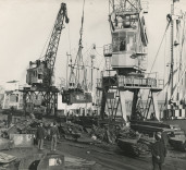 Photograph showing loading scrap metal at Blyth Harbour, Blyth, Northumberland.